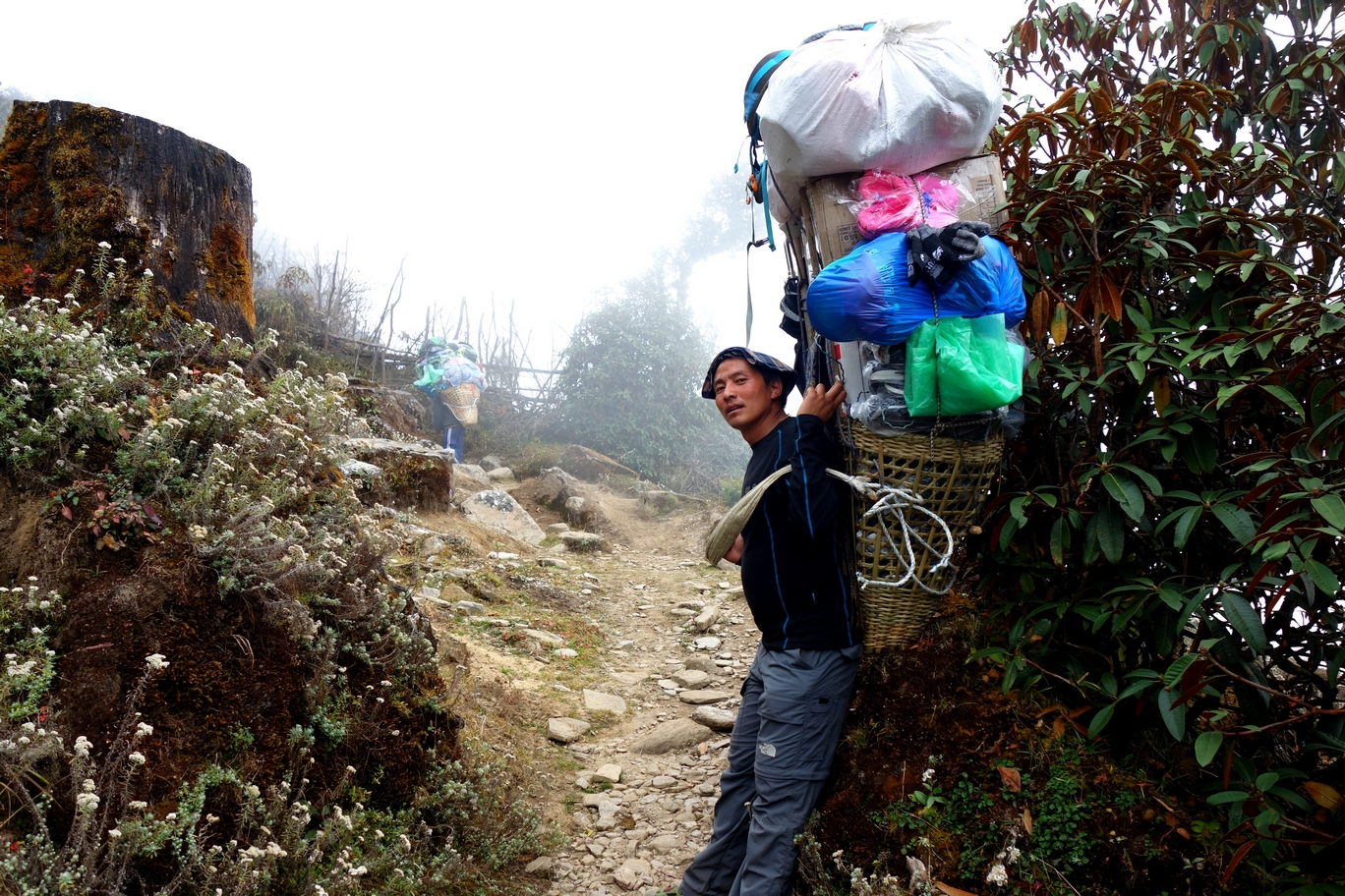 This is a porter I crossed paths with on the way down to Kinja. His load was 80kg, he said (that's 176 pounds for you Americans). His friend, (in the background) was carrying 100kg.